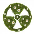 Stock Photo: Nuclear symbol from green moss and flowers