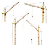 Set of four yellow hoisting cranes isolate on white — Stock Photo