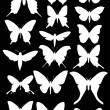 Set of seventeen white butterfly wings shapes — Stock Vector