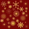 Gold snowflakes collection on red background — Stock Vector
