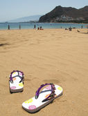 Flip-flops in the sand of Teresitas beach. Tenerife island, Cana — Stock Photo