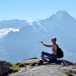 Traveler on the top of a rock. Jungfrau region, Switzerland — Stock Photo