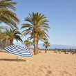 striped umbrella on the teresitas beach of tenerife island. cana — Stock Photo