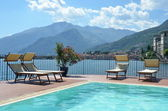 Row of sunbeds against Como lake, Italy — Stock Photo