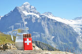 Swiss chocolate and jug of milk against mountain peak. Switzerla — Foto Stock