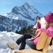 Girl with a camera in the Swiss Alps — Stock Photo