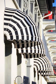 Striped awnings of a restaurant — Stock Photo