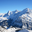 Eiger, Moench and Jungfrau, famous Swiss mountain peaks — Stock Photo #20833175