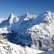 Eiger, Moench and Jungfrau, famous Swiss mountain peaks — Stock Photo #20833781