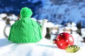 Tea pot in the cap against alpine scenery — Stock Photo