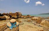 Straw hat on the rock. Phuket island, Thailand — Stock Photo