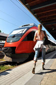 Girl rushing to catch the train — Stock Photo