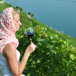 Woman tasting red wine in Lavaux, Switzerland — Stock Photo #20882443