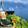Red wine and grapes on the terrace of vineyard in Lavaux region, — Stock Photo #20882931