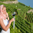 Woman tasting red wine in Lavaux, Switzerland  — Stock Photo