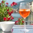 Traditional Italian Spritz cocktail against lake Como, Italy — Stock Photo