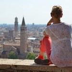 Girl looking to Verona town, Italy — Stock Photo