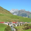 Train passing a bridge. Furka pass, Switzerland — Stock Photo