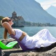 Stock Photo: Young womtaking sunbath at Genevlake, Switzerland