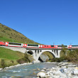 Train passing a bridge. Switzerland — Stock Photo