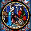 Nativity Scene. Stained glass window in the Basel Cathedral. - Stock Photo