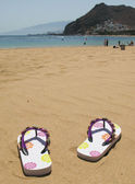 Flip-flops on the sand of Teresitas beach. Tenerife island, Cana — Stock Photo
