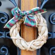 Stock Photo: Christmas wreath on door
