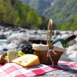 Red wine, cheese and grapes served at a picnic. Verzasca valley, - Stock Photo