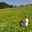 Girl with a laptop on the meadow — Stock Photo #20935899
