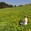 Girl with a laptop on the meadow — Stock Photo
