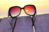 Ocean sunset through the sunglasses — Stock Photo