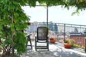Two chairs overlooking lake Como, Italy — Stock Photo
