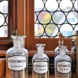 Stockfoto: Empty scent bottles in old pharmacy