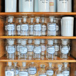 Stock Photo: Empty scent bottles in old pharmacy