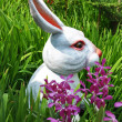 Easter bunny in the grass - Stock Photo