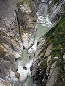 Furious mountain stream at St. Gotthard pass, Switzerland — Stock Photo