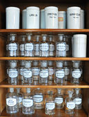 Bottles on the shelf of an old pharmacy — Stock Photo