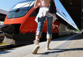 Girl rushing to catch the train — Stock Photo