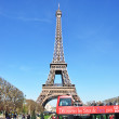 Stock Photo: PARIS - APRIL 6: Excursion bus against Eiffel tower on April 6,