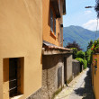 Narrow street of Menagio town at the famous Italian lake Como — Stock Photo #21025047