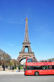 PARIS - APRIL 6: Excursion bus against Eiffel tower on April 6, — Stock Photo