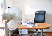 Fan in the office leafing a book — Stock Photo