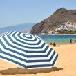 Striped umbrella on the Teresitas beach of Tenerife island. Cana - Stock Photo