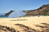 Striped umbrella on the Teresitas beach of Tenerife island. Cana — Stock Photo