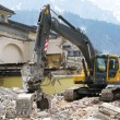 Excavator demolishing an old building — Stock Photo