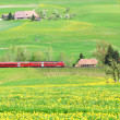 Alpine express in Emmental region, Switzerland - Stock Photo