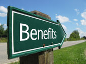 BENEFITS road sign — 图库照片