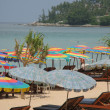 Colorful sun umbrellas at Surin beach of Phuket island — Stock Photo