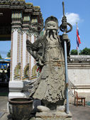 Stone guard at the door of Wat Po temple in Bangkok — Stock Photo