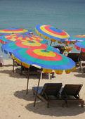Colorful sun umbrellas at Surin beach of Phuket island — Stock Photo